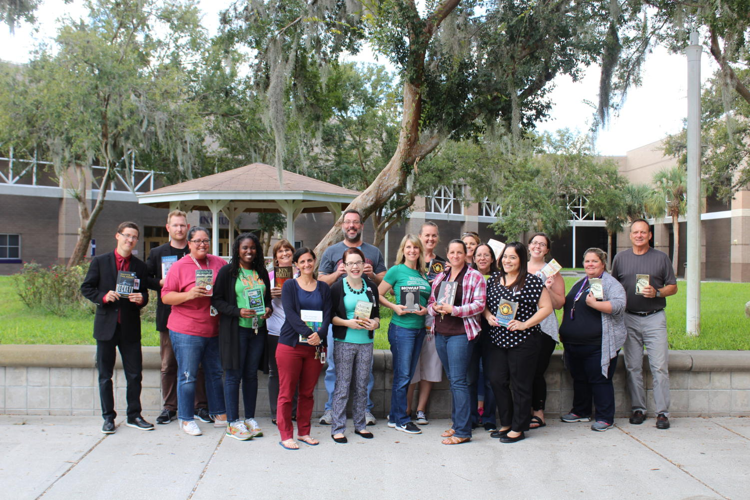 Winter Springs High School English teachers pose with their favorite books. (Courtesy of WSHS Yearbook)