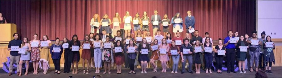 The Class of 2021 IB Diploma Candidates hold their certificates proudly at their ceremony on November 19, 2019.