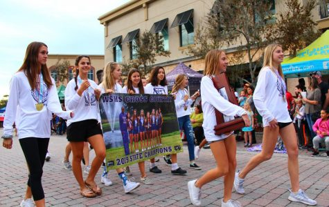 Cross Country champions walk in Winter Springs parade.